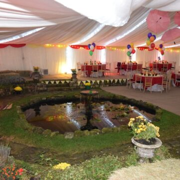Garden pond and flower beds inside the circus marquee
