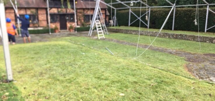Putting up the frame work of the marquee
