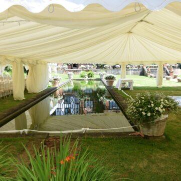 Wedding Marquee Built Around A Pond