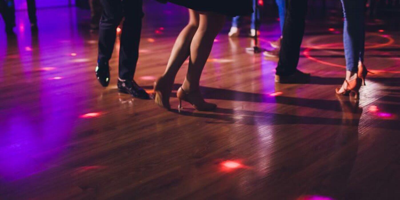 guests dancing on wooden dance floor