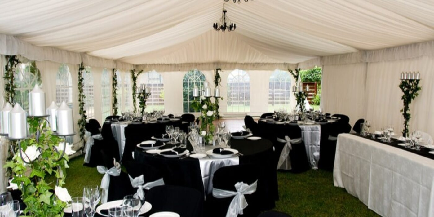 marquee-for-a-wedding-black-table-cloth